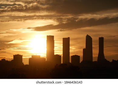 The sunset behind the Cuatro Torres de Madrid seen from the Valdebebas forest park. Spain