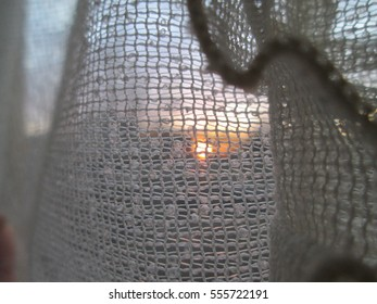 Sunset behind curtains