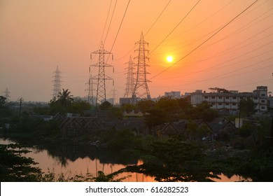 Sunset behind electrical power lines in Chennai City, India.