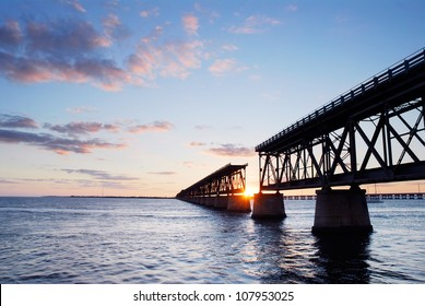 Sunset behind the historic railroad bridge at Bahia Honda State Park in the Florida Keys