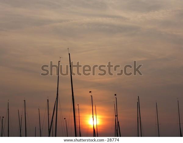Sunset behind a marina.