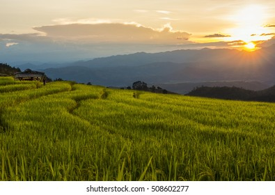 Sunset behind the mountain at Bong Piang, casting the golden field - Shutterstock ID 508602277