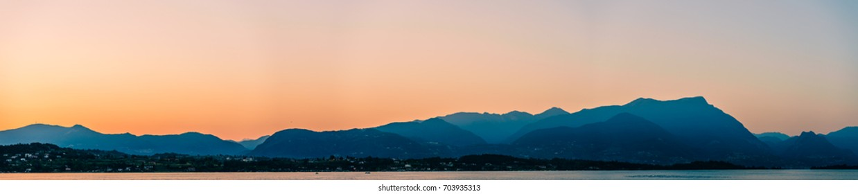 Sunset behind a mountain range at Lake Garda, Itlay