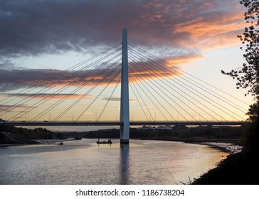Sunset behind the northern spire suspension bridge in Sunderland, England. Opened in 2018