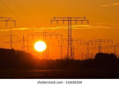 Sunset behind a power line