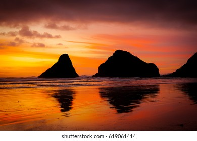 sunset behind rock formations at Devil's Elbow State Park near Florence on the Oregon Coast.