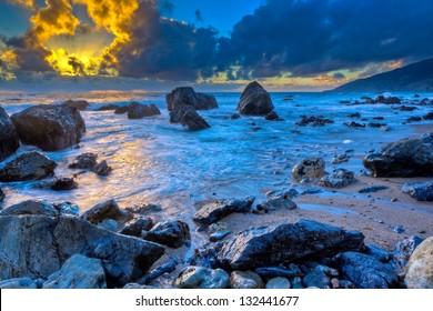 Sunset behind storm clouds, Big Sur, California
