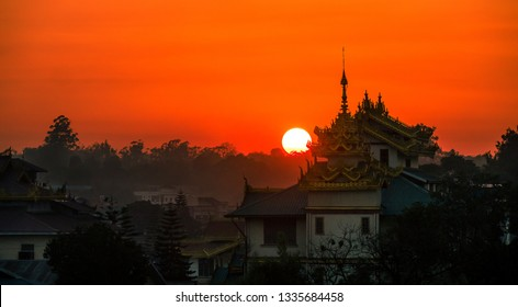 Sunset behind traditional old pagoda temple in Myanmar, Burma