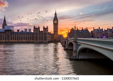 Sunset behind the Westminster Palace and the Big Ben clocktower in London, United Kingdom
