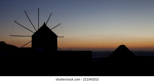 Sunset behind a windmill (Oia, Santorini, Greece)