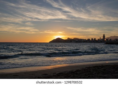 Sunset at Benidorm in Spain, taken at the Cala del Mal Pas beach overbook Benidorm beaches, hotels and high-rise apartments.
