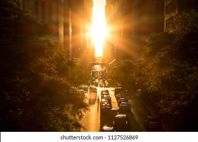 Sunset between the buildings on 42nd Street in Manhattan New York City