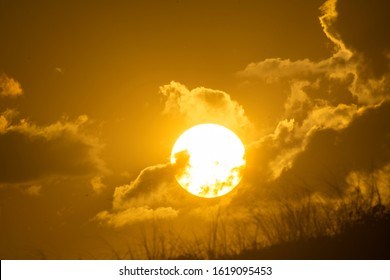 Sunset between clouds in a natural landscape