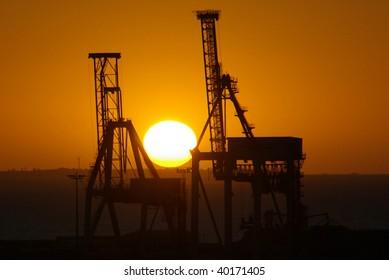 Sunset between cranes