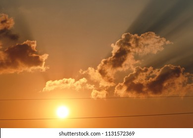 sunset between electrical wires