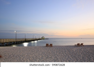 Sunset in Biloxi beach, Mississippi, along Gulf Coast shore