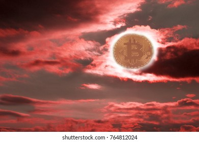 Sunset bitcoin. The fall of bitcoin. Coin bitcon instead of the sun. Red sunset with dark clouds.