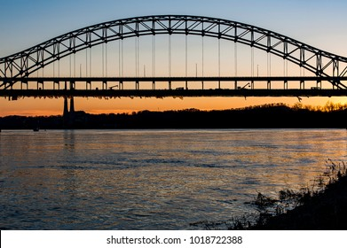 A sunset / blue hour view of the distinctive Sherman Minton Bridge that carries US 150 and Interstate 64 over the Ohio River between Louisville, Kentucky and New Albany, Indiana.
