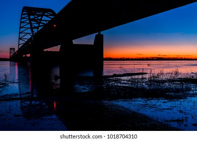 A sunset / blue hour view of the steel arch Paducah Bridge which carries Interstate 24 over the Ohio near Paducah, Kentucky.