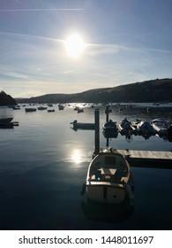 Sunset. Boat on Salcombe Harbor.