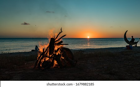 Sunset and Bonfire at the beach on Curacao