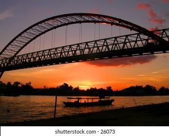 Sunset, bridge, and boat
