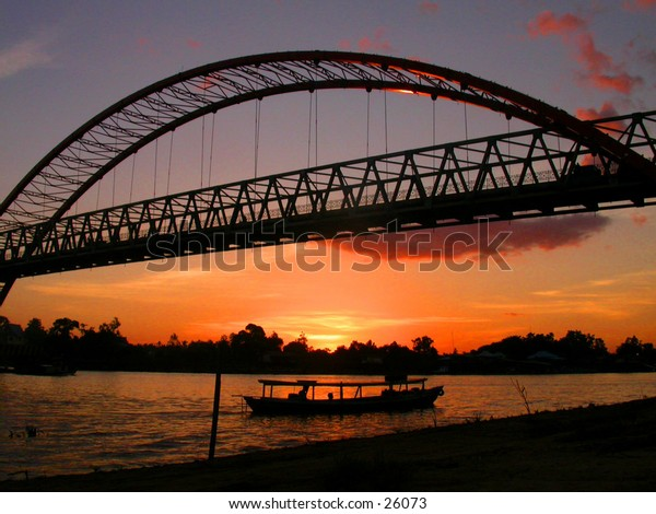 Sunset, bridge, and boat