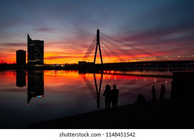 Sunset at the bridge on the Daugava River in Riga