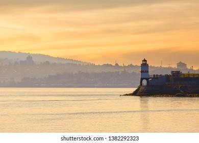 Sunset at Brockton Point Lighthouse on Stanley Park in Vancouver BC Canada