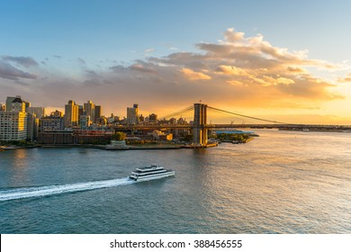 Sunset in Brooklyn New York with a ferry boat passing by in the eat river