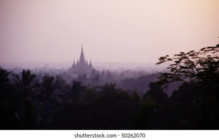 Sunset with buddhist temple in Bago, myanmar, burma