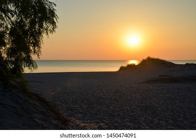 Sunset by an empty sandy beach at the swedish island Gotland