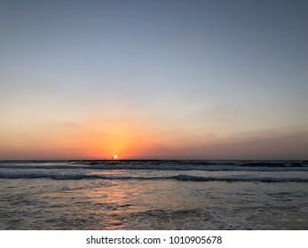 Sunset by the sea at Tel Aviv beach