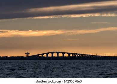 Sunset by the swedish Oland bridge connecting the island Oland with mainland Sweden