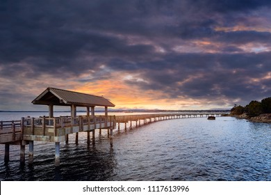 Sunset by Taylor Dock Shelter at Boulevard Park Boardwalk in Bellingham Washington