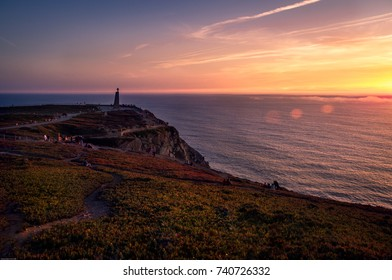 Sunset at Cabo da Roca, the westernmost point of the mainland Europe with beautiful cliffs and clouds over Atlantic Ocean - Sintra, Portugal