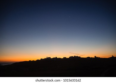 Sunset at Cabo Polonio in the atlantic coast of Uruguay in Rocha department. Houses silhouette