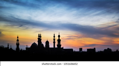 Sunset in Cairo from Al Azhar Park, In the background the two minaret of mosques Al-Rifa'i and Sultan Hassan in Cairo Egypt