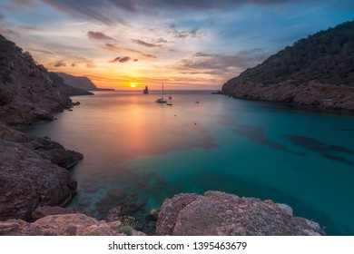 Sunset in Cala Benirras , Ibiza  with beautiful and cloudy sky