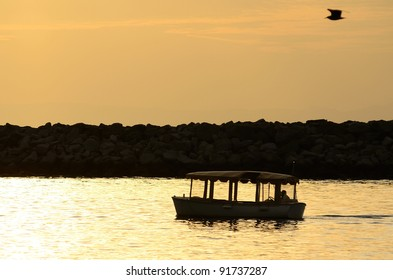 Sunset and canopy boat at Newport Beach in the southwest part of Los Angeles CA