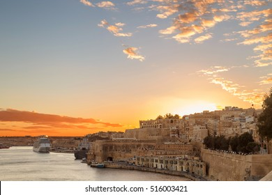 Sunset in the capital city of Malta, Valletta, known as Il-Belt in Maltese. View on The Grand Harbour.