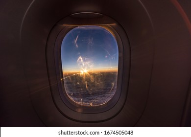 sunset captured in an airplane high above the skies