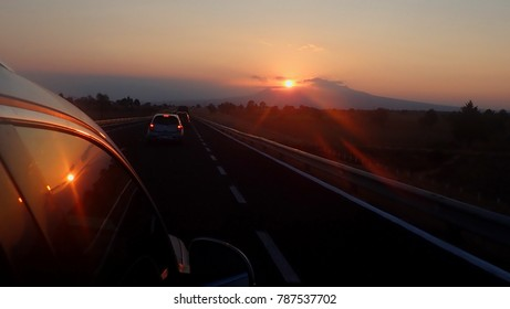 Sunset from the car in the road
