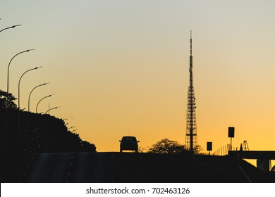 Sunset, a car and tv tower of Brasilia, Federal District, Brazil.