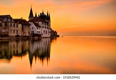 Sunset castle lake water reflection. Sunset lake castle reflection. Sunset caslte lake. Sunset lake castle panorama