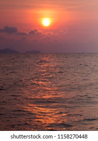 Sunset casts a beacon of light across the ocean in east Thailand
