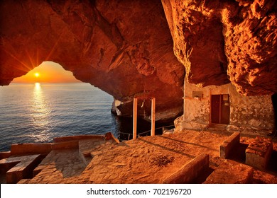 Sunset at the cave of the church of Agios Stefanos, close to Galissas village, Syros island, Cyclades, Aegean sea, Greece