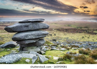Sunset at the Cheesewring on Bodmin Moor in Cornwall, a weathered natural rock formation made up of  precariously balanced granite slabs