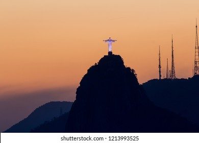 Sunset and Christ the Redeemer / Cristo Redentor art deco statue in Rio de Janeiro Brazil on Mount Corcovado taken from Sugarloaf Mountain