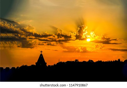 Sunset church cross silhouette in sunset sky clouds. Sunset church silhouette. Sunset sky clouds panorama